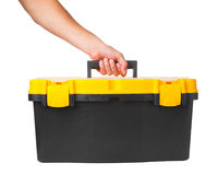 Tool box in hand. Isolated on white Stock Photography