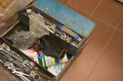 Tool box of a plumber who does home work related to plumbing. Photograph from above of a toolbox that is on the floor and belongs to a plumber who does home work royalty free stock images