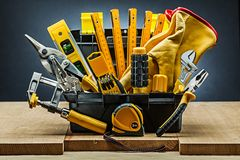 Tool box wirh many construction tools on wood boards. Tool box wirh many construction tools on w ood boards royalty free stock images
