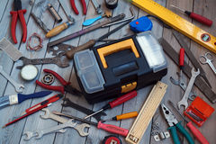 Tool box on wooden floor, view from above. Stock Photography
