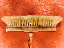 The tool a brush for dust sweeping. аgainst a wall Royalty Free Stock Photos