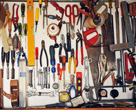 Tool cabinet in the garage of the house. Panoply of tools for use on the needs of the home, do it yourself royalty free stock photography