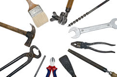 Tool Circle. Old used vintage tools in a circle over a white background Royalty Free Stock Photo