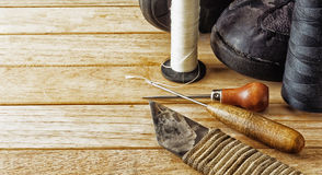 Tool cobbler and Shoe repair. Tool for shoes repair and shoes Royalty Free Stock Image