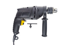 Tool drill. Black on a white background Stock Photos