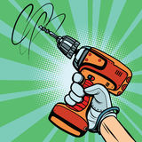 Tool electric drill in hand Royalty Free Stock Photography