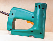 The tool - an electrical stapler for repair work.Close up Stock Images