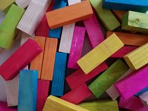 Bunch of small tables painted in various colors and disorganized, background and texture. Tool for fun and entertainment, children's toys royalty free stock photography