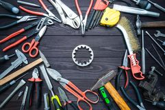 Tool gears and heart on dark wooden background. Love for your work, Father`s Day royalty free stock photo