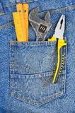 Tool in jeans pocket Royalty Free Stock Images
