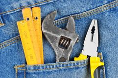 Tool in jeans pocket Stock Photo