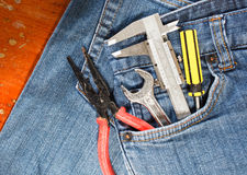 tool kit in jean pocket Stock Photo