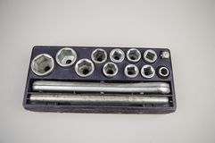 Tool kit - wrench heads with ratchet wrench, old royalty free stock image