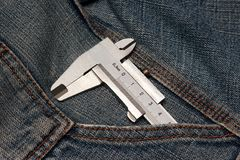 Tool micrometer in jeans pocket Stock Photo