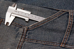 Tool micrometer in jeans pocket Stock Photography