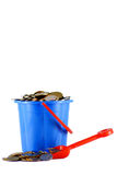 The tool for money. Nurseries bucket and a scoop filled with money Stock Image
