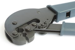 Tool for mounting CATV connectors. On the coaxial cable Stock Images