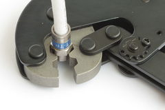 Tool for mounting CATV connectors. On the coaxial cable Royalty Free Stock Image