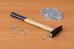 Tool and nails on wooden background royalty free stock photography