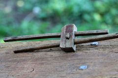 Tool. Old wooden tool for measuring lying on a wooden bench Royalty Free Stock Image