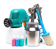 Tool for a painting of surfaces - spray gun electrical and manual mechanical and small bottles with color Stock Photo