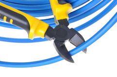 Tool pliers cutting blue cable Royalty Free Stock Images
