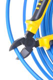 Tool pliers cutting blue cable Royalty Free Stock Photo