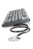 Tool a programmer, keyboard.Stethoscope Stock Photo