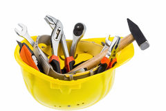 Tool in a protective helmet Royalty Free Stock Images