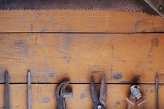 Tool renovation on grunge wood Stock Image