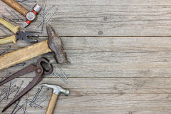 Tool set of hammers, pliers, pincers and nails on grey grunge wo Royalty Free Stock Photo