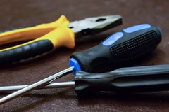 Free Tool Set Pliers Yellow Long Screwdrivers Fixation Home Tools Electrical Repair Stock Image - 144110091