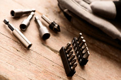 Tool set of screwdriver bits with different nozzles on wooden de Royalty Free Stock Images
