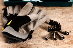 Tool set of screwdriver bits with different nozzles on wooden de Stock Photography