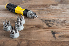 Tool set screwdriver with different nozzles. Tool set screwdriver with different nozzles Royalty Free Stock Photos