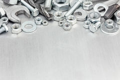 Tool set of various screws and bolts with wrench on metal backgr Royalty Free Stock Photography