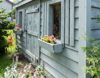Tool shed. Wooden garden shed surrounded by foliage Stock Photography