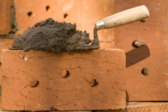 Tool shovel  clay brick Stock Images