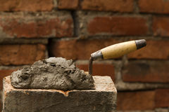 Tool   shovel   glue    cement Royalty Free Stock Images