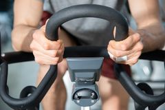 Detail of the handlebar of an exercise bike fitness. Tool similar to a bicycle and designed to reproduce the cycling movement indoors indoors royalty free stock photo