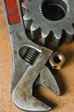 Tool still-life. Tool, cog-wheel and nut, wrench, spanner Royalty Free Stock Image
