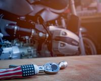 Tool on the table with single cylinder head cover of a motorcycle Stock Image