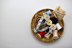 Tool. Threads and tape measure in basket on white background Royalty Free Stock Photo