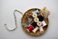 Tool. Threads and tape measure in basket on white background Stock Image