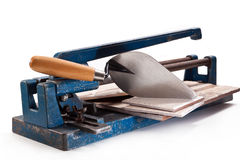 Tool for tiler. Tools for cutting ceramic tile, trowel on a white background Stock Photos