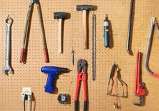 Tool Wall. Various tools hanging from a pegboard wall Royalty Free Stock Photos