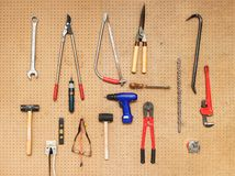 Tool Wall. Various tools hanging on a pegboard wall Royalty Free Stock Image