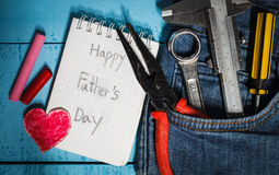 Tool with word happy father day. Paper on wood Stock Image