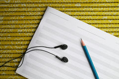 Tool for writing music. There are tools for  writing song such as earphone pencil and staff sheet Royalty Free Stock Photo