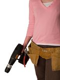 Toolbelt. Girl holding a drill isolated against a white background Royalty Free Stock Photo